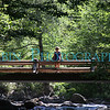 A woman on the new bridge at Happy Isles, Yosemite Valley.
